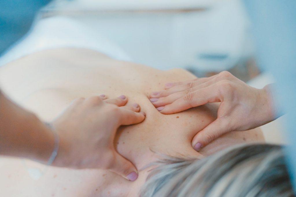 hands massaging woman